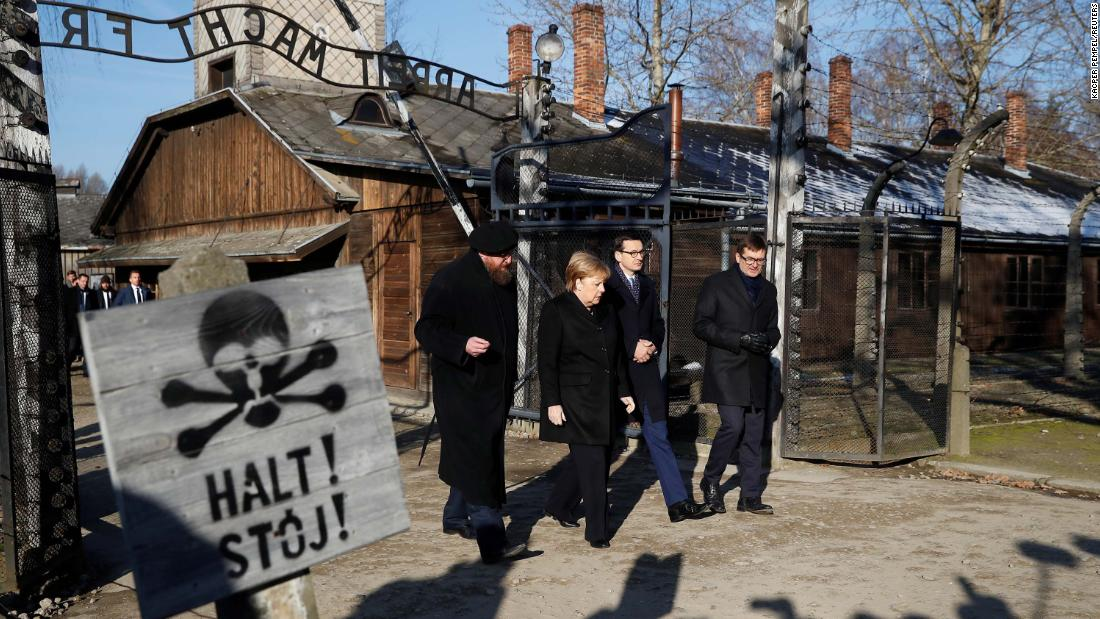Angela Merkel visits Auschwitz for the first time in 14 years as Germany's leader